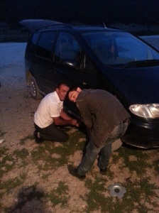 Caught in the act: Arian and the nice mute chap attempt to change the tyre I burst without my noticing