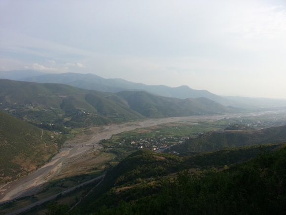 View from the hills separating Labinot from the main road. The bridge spanning the Shkumbini is a postwar replacement for the one blown by David Smiley in 1943