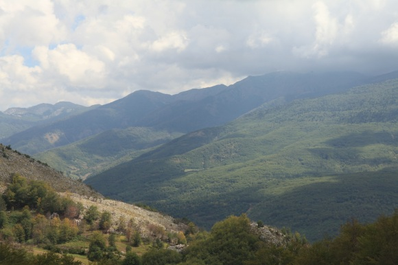 The view to Macedonia, from the hills above the village of Khorishte. Wolves, bears and lynx roam the forests. This is wild country - sheep and goat herders invariably carry rifles
